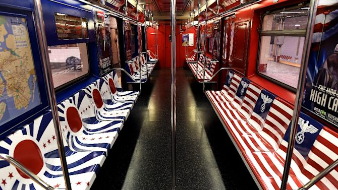 """New York subway seats are seen covered in ads featuring the Nazi German eagle and Imperial Japan's rising sun promoting the Amazon TV show """"The Man in the High Castle"""""""