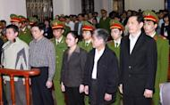 Pham Thanh Binh (front R), former chairman of Vinashin, a major state-owned shipbuilder, and other executives of the group are sentenced to prison at the People's Court in the Vietnamese city of Hai Phong in March 2012. Eight former top executives have appealed against lengthy prison sentences handed to them over their role in the company's near-collapse