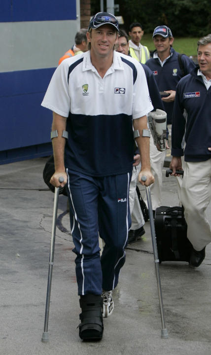 FILE - In this Friday, Aug. 5, 2005 file photo, Australia bowler Glenn McGrath walks with the aid of crutches as he arrives at Edgbaston cricket ground in Birmingham, England, before the second day of