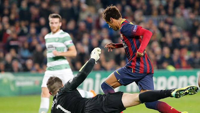 Barcelona's Neymar, right, challenges Celtic goalkeeper Fraser Forster during a Group H Champions League soccer match between FC Barcelona and Celtic FC at the Camp Nou stadium in Barcelona, Spain, Wednesday Dec. 11, 2013