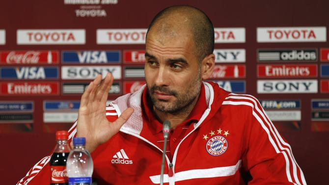 Bayern Munich's head coach Pep Guardiola gestures while speaking during a news conference in Agadir