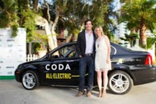 Amy Smart and her husband with a CODA car.
