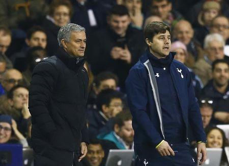 Chelsea manager Jose Mourinho and Tottenham Hotspur manager Mauricio Pochettino watch play during their English Premier League soccer match at White...