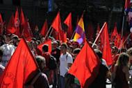People take part in a demonstration in Madrid on September 15. Mass protests in Spain and Portugal, against ever tougher austerity measures, have ramped up the pressure on Iberian governments struggling to avoid international bailouts.