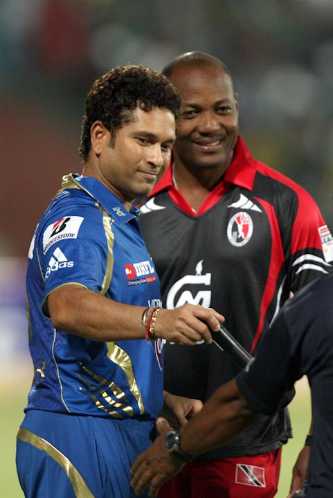 Sachin Tendulkar and Brian Lara during the CLT20 match between Perth Scorchers and Mumbai Indians at Feroz Shah Kotla, Delhi on Oct. 2,2013. (Photo: IANS)