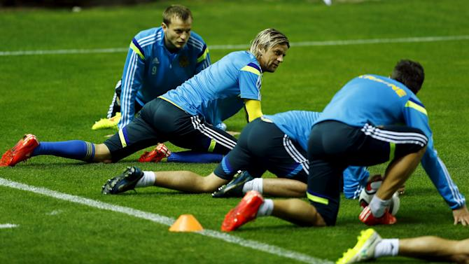 Ukraine's national soccer team players Husyev and Tymoshchuk stretch next to teammates during a training session ahead of Euro 2016 qualifier in Seville