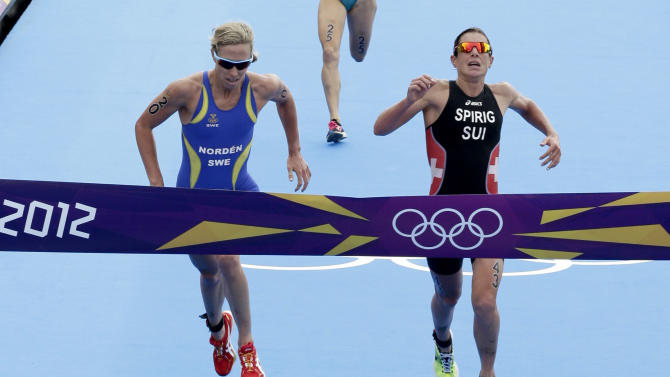 Nicola Spirig of Switzerland wins the women's triathlon final during the London 2012 Olympic Games at Hyde Park