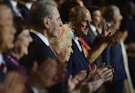 Britain's Queen Elizabeth (C), her husband Prince Philip (centre R) and International Olympic Committee (IOC) President Jacques Rogge (centre L) applaud during the opening ceremony of the London 2012 Olympic Games at the Olympic Stadium in London