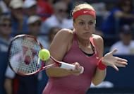 Sabine Lisicki of Germany returns the ball against Ekaterina Makarova of Russia during their 2013 US Open women's singles match at the USTA Billie Jean King National Tennis Center in New York on August 30, 2013