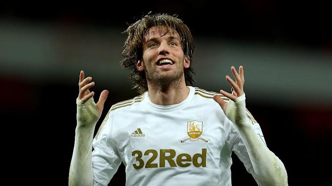 Tony Mowbray knows in-form Michu, pictured, can pose his Middlesbrough side problems