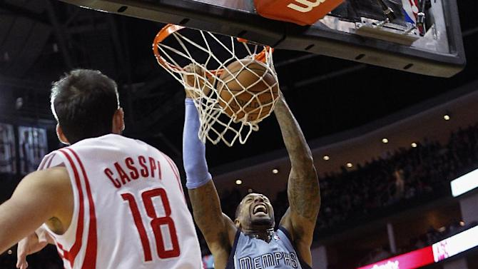 Memphis Grizzlies forward James Johnson (3) dunks in front of Houston Rockets' Omri Casspi (18) during the first half of an NBA basketball game Thursday, Dec. 26, 2013, in Houston