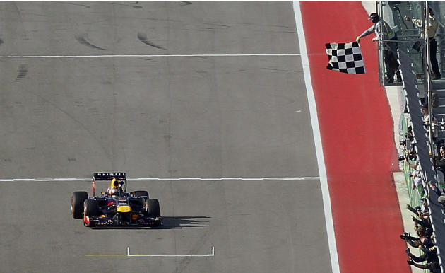 Sebastian Vettel of Germany takes the checkered flag to win the Austin F1 Grand Prix at the Circuit of the Americas in Austin