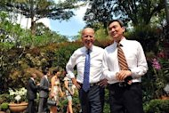 US Vice President Joe Biden (C) chats to Singapore's National Parks CEO Poon Hong Yuen during a visit to the National Orchid Garden, in Singapore, on July 26, 2013. Biden Friday called on Asian nations to reduce tensions in disputed waters across the region as Washington redoubles efforts to confront China's growing maritime presence there