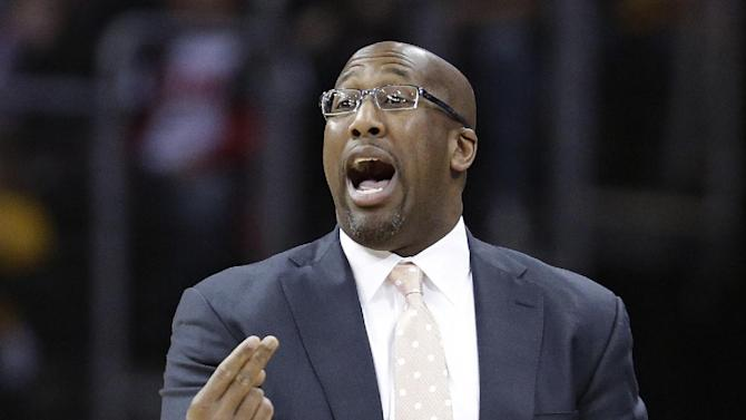 Cleveland Cavaliers coach Mike Brown gestures during the first quarter of an NBA basketball game against the Orlando Magic on Thursday, Jan. 2, 2014, in Cleveland. The Cavaliers won 87-81 in overtime