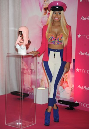 Nicki Minaj Launches 'Pink Friday' Fragrance In Barbie Outfit And PVC Police Hat