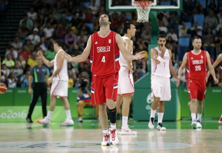 Serbia's Milos Teodosic (4) reacts after making a three-point basket during a quarterfinal round basketball game against Croatia at the 2016 Summer Olympics in Rio de Janeiro, Brazil, Wednesday, Aug. 17, 2016. (AP Photo/Charlie Neibergall)