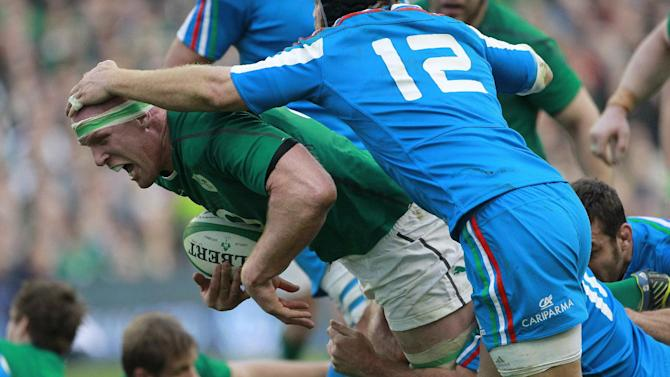 Ireland's Paul O'Connell is tackled by Italy's Gonzalo Garcia, right, during their Six Nations Rugby Union international match at the Aviva Stadium, Dublin, Ireland, Saturday, March 8, 2014. (AP Photo/Peter Morrison)
