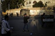 An Egyptian man carries a table outside the presidential palace in Cairo on December 12, 2012, one day after thousands of Egyptians protested against the upcoming referendum on the new draft constitution