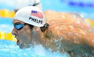 US swimmer Michael Phelps competes in the men's 200m butterfly heats swimming event at the London 2012 Olympic Games at the Olympic Park in London on July 30