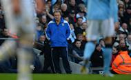 Leeds United's English manager Neil Warnock (C) looks on during the fifth round English FA Cup football match between Manchester City and Leeds United at the Etihad Stadium in Manchester on February 17, 2013. Leeds United's vociferous 6,000 travelling fans turned on Warnock during their side's 4-0 FA Cup humiliation at City - and the boss revealed he was ready to bow to pressure to stand down