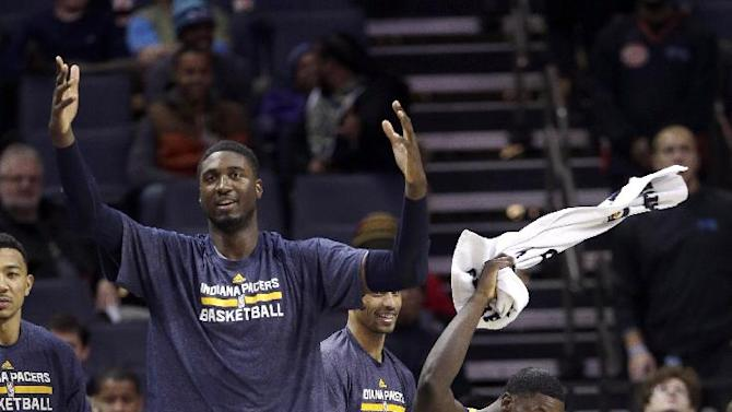 Indiana Pacers' Roy Hibbert, left, and Lance Stephenson, right, celebrate as a teammate makes a basket against the Charlotte Bobcats during the second half of an NBA basketball game in Charlotte, N.C., Wednesday, Nov. 27, 2013. The Pacers won 99-74