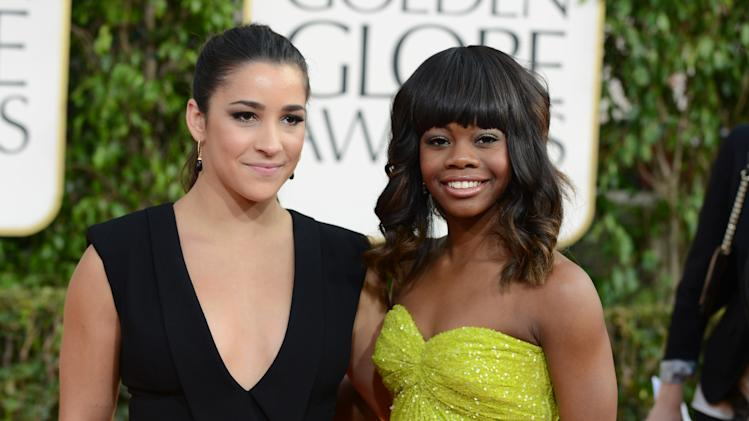 Olympic gymnasts Aly Raisman, left, and Gabby Douglas arrive at the 70th Annual Golden Globe Awards at the Beverly Hilton Hotel on Sunday Jan. 13, 2013, in Beverly Hills, Calif. (Photo by Jordan Strauss/Invision/AP)