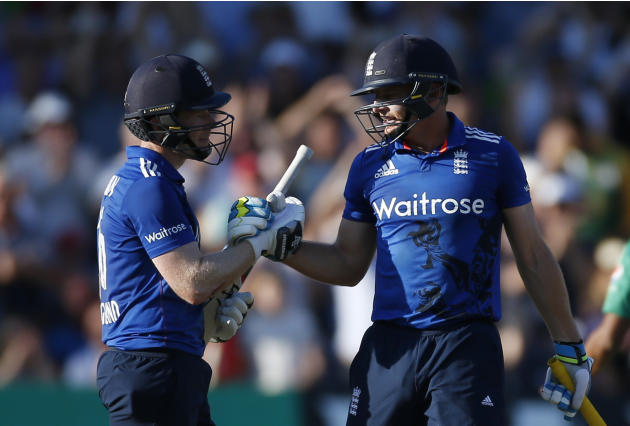 England's Eoin Morgan and Jos Buttler (R) celebrate after breaking the record for an ODI score