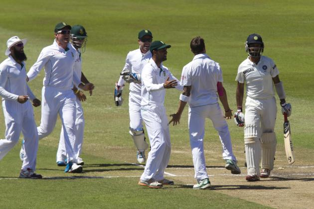 South Africa's players celebrate the wicket of India's Pujara during the fifth day of the second test cricket match Durban