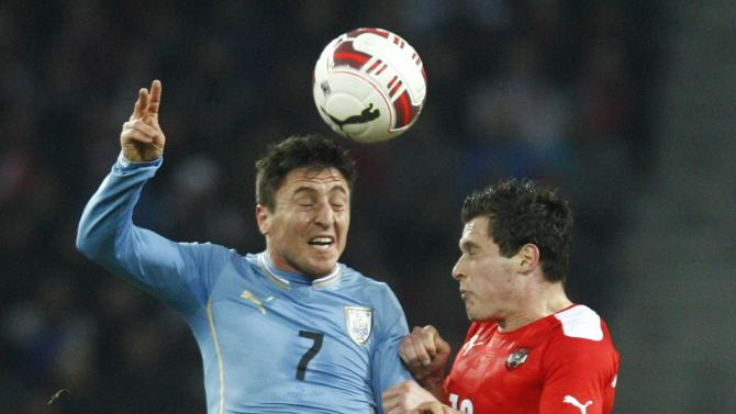 Austria's Junuzovic and Uruguay's Rodriguez fight for the ball during their international friendly soccer match in Klagenfurt