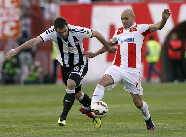 Red Star Belgrade's Stojanovic is challenged by Partizan Belgrade's Drincic during their Serbian Superliga soccer match in Belgrade