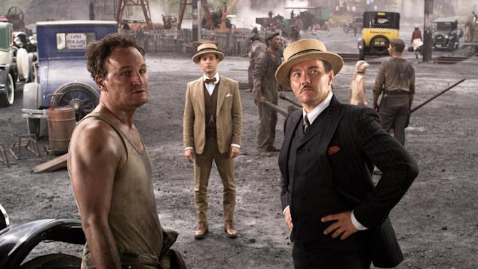 """This film publicity image released by Warner Bros. Pictures shows Jason Clarke as George Wilson, left, Tobey Maguire as Nick Carraway, center, and Joel Edgerton as Tom Buchanan, right, in a scene from """"The Great Gatsby."""" (AP Photo/Warner Bros. Pictures)"""