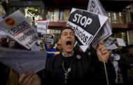 Demonstrators in Madrid protest house evictions on November 12. EU finance ministers are tackling ways of boosting the slumping economy as the debt crisis bites deeper, after eurozone ministers reported progress overnight on the Greek bailout