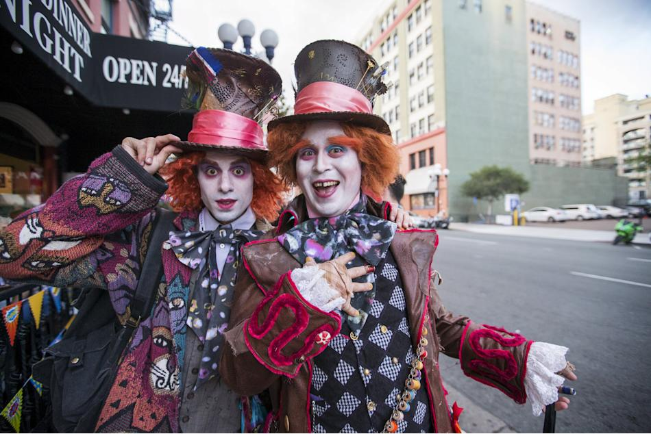 Cosplay enthusiasts Michael and Breen are dressed like the Mad Hatter from
