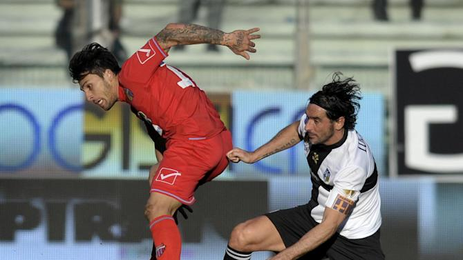 Parma's Alessandro Lucarelli, right, vies for the ball with Catania's Mariano Izco of Argentina, during their Serie A soccer match at Parma's Tardini stadium, Italy, Sunday, Feb. 9, 2014
