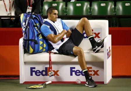 Nick Kyrgios of Australia sits on the bench during his men's singles tennis match against Benoit Paire of France at the Japan Open championships in Tokyo