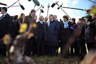 France's incumbent president and candidate for the 2012 presidential election, Nicolas Sarkozy (C) talks with wine growers in Vouvray. He went gunning for more than six million far-right votes in a bid to catch up with Socialist Francois Hollande who took the lead in round one of the French presidential election