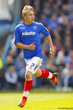 Ashley Harris has signed a deal which keeps him at Portsmouth until 2014