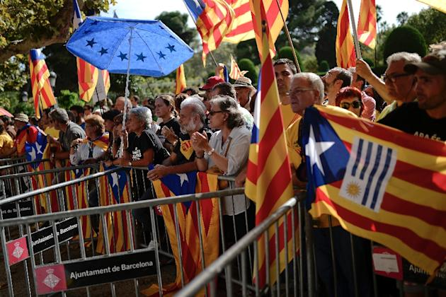 Demonstrators holding Catalan independence flags outside the Parliament of Catalonia in Barcelona on September 19, 2014