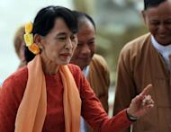 The United States will present its highest award to Myanmar's democracy leader Aung San Suu Kyi in September when she makes her first US trip since years under house arrest, sources said Tuesday