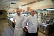 French Elysee presidential palace chef Bernard Vaussion (R) and his successor Guillaume Gomez (L) pose in the kitchen on October 31, 2013 at the Elysee palace in Paris