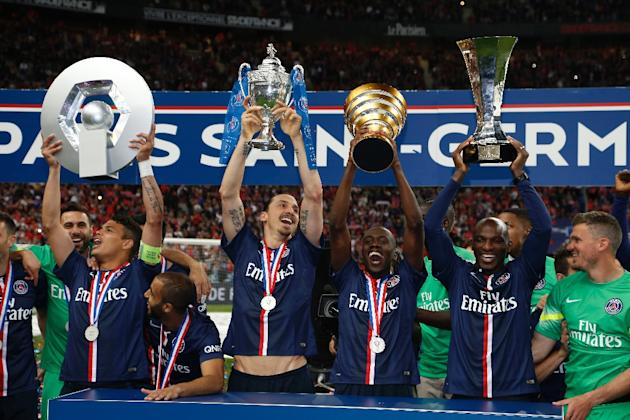 (L-R) PSG's Thiago Silva holding up the Ligue 1 trophy, Zlatan Ibrahimovic holding up the French Cup trophy, Blaise Matuidi holding the French League Cup and Zoumana Camara holding the Champions&#