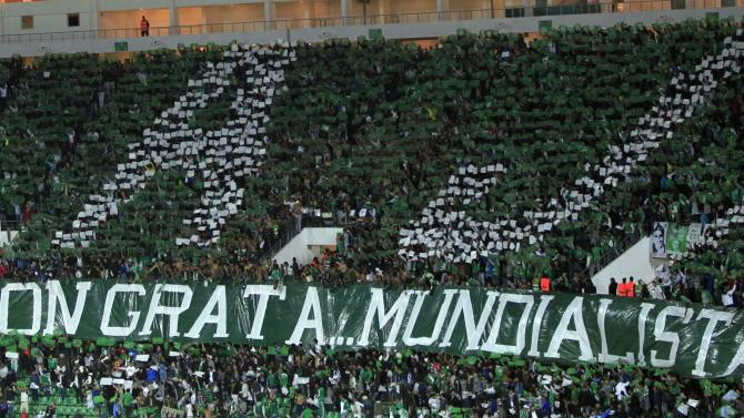 Fans of Raja Casablanca celebrate cheer during FIFA Club World Cup soccer match against Auckland City FC in Agadir