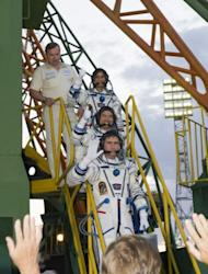 Image provided by NASA shows Expedition 32 Soyuz Commander Yuri Malenchenko (bottom), JAXA Flight Engineer Akihiko Hoshide and NASA Flight Engineer Sunita Williams (top) wave farewell from the base of the Soyuz rocket at the Baikonur Cosmodrome in Kazakhstan on July 15