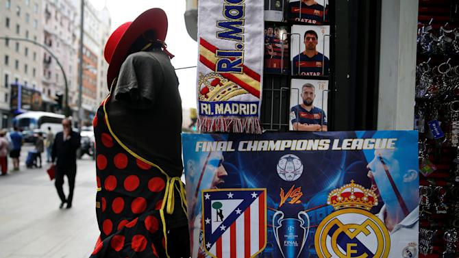 Souvenirs of the UEFA Champions League Final between Atletico Madrid and Real Madrid are displayed at a souvenir store in downtown Madrid
