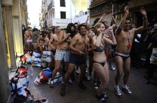 People clad in only their underwear queue outside the Spanish retail store.