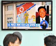 "People in Seoul watch a TV report May 2, 2013 on Kenneth Bae, a Korean-American tour operator detained in North Korea. North Korea said Sunday it would not invite any leading US figure to seek the release of a jailed American, adding he would not be a ""political bargaining chip"" in any negotiations with the United States"