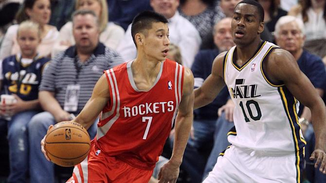 Houston Rockets' Jeremy Lin (7) drives to the basket as Utah Jazz's Alec Burks (10) defends in the second half during an NBA basketball game Saturday, Nov. 2, 2013, in Salt Lake City. The Rockets defeated the Jazz 104-93