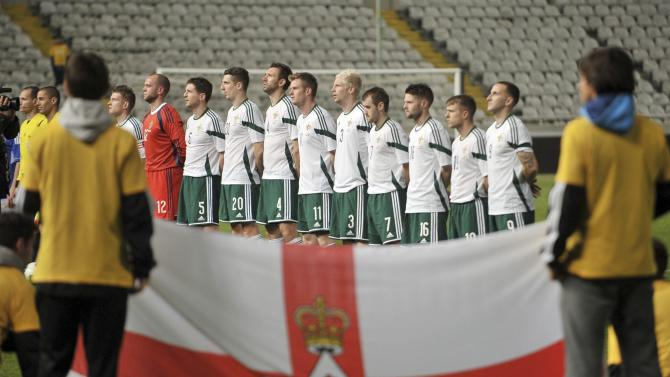 North Ireland's national soccer team players pose for a group photo before their match against Cyprus during their International friendly football match at Gsp Stadium