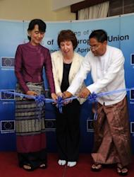 "The EU's foreign policy chief Catherine Ashton (centre), Yangon division chief minister Myint Swe (right) and Myanmar opposition leader Aung San Suu Kyi open the European Union bureau in Yangon. Ashton urged Myanmar to make its political reforms ""irreversible"" and called for an end to bloody ethnic conflict"