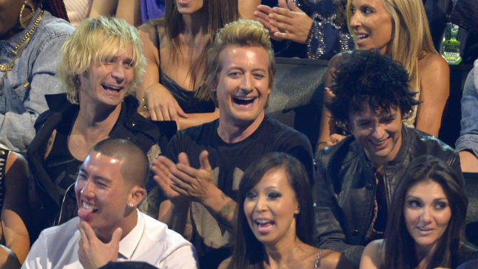 Members of Green Day, from left, Mike Dirnt, Tre Cool and Billie Joe Armstrong sit in the audience at the MTV Video Music Awards on Thursday, Sept. 6, 2012, in Los Angeles. (Photo by Mark J. Terrill/Invision/AP)